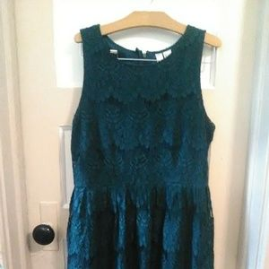 Dark green lace fitted mini dress